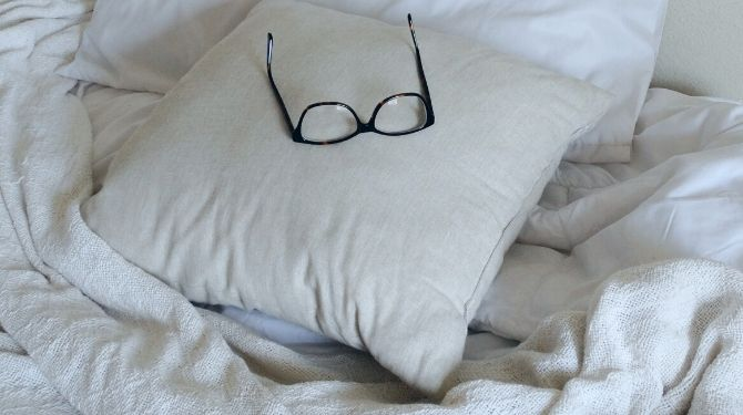glasses pillow and bed