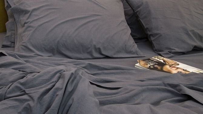 bed with blue sheets